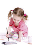 Funny little girl drawing the picture Stock Images