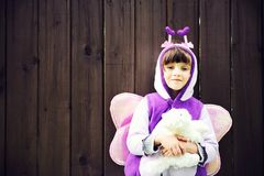 Funny little girl dressed in a butterfly suit Stock Image