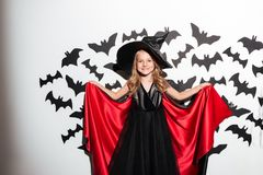 Funny little girl dressed in halloween costume posing Royalty Free Stock Photography
