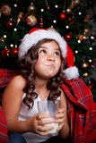 Funny little girl drinking a glass of milk Royalty Free Stock Photos