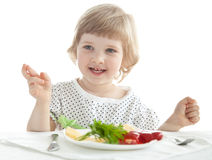 Funny little girl eating stock photography