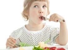 Funny little girl eating her dinner Royalty Free Stock Images