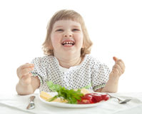 Funny little girl eating her dinner Royalty Free Stock Photo