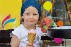 Funny little girl eating ice cream. Royalty Free Stock Photo