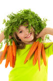 Funny little girl with fresh carrots Stock Photos
