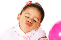 Funny little girl giving a kiss Stock Images