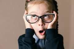 Surprised little girl with glasses stock photos