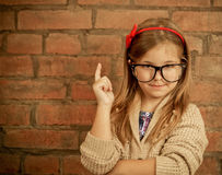 Funny little girl with glasses Stock Image