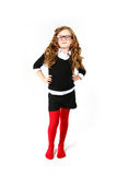 Funny little girl with glasses looking at the camera on a white Royalty Free Stock Photos