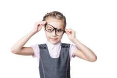 Funny little girl in glasses makes faces Stock Photos