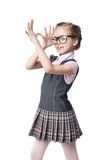 Funny little girl in glasses makes faces Royalty Free Stock Photo