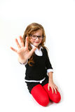 Funny little girl with glasses making the sign five or hello iso Royalty Free Stock Images