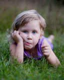 Funny Little Girl in Grass Stock Photography