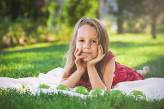 Funny little girl with green apples Royalty Free Stock Image