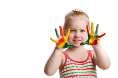 Funny little girl with hands painted in colorful paint. Isolated Royalty Free Stock Photo