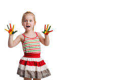 Funny little girl with hands painted in colorful paint. Isolated Royalty Free Stock Photos