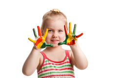 Funny little girl with hands painted in colorful paint. Isolated Stock Images