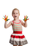 Funny little girl with hands painted in colorful paint. Isolated Stock Image