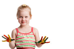 Funny little girl with hands painted in colorful paint. Isolated Royalty Free Stock Images