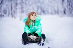 Funny little girl having fun in beautiful winter park royalty free stock images