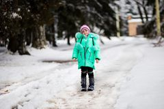 Funny little girl having fun in beautiful winter park stock images