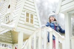 Funny little girl having fun in winter park Royalty Free Stock Photography