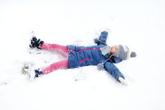 Funny little girl having fun in winter park Stock Photography