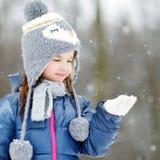Funny little girl having fun in winter park Stock Photos