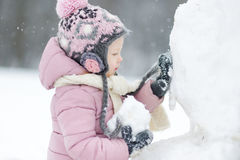 Funny little girl having fun in winter park Royalty Free Stock Photos