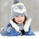 Funny little girl having fun in winter park Royalty Free Stock Photo