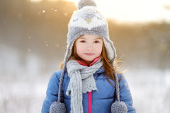 Funny little girl having fun in winter park Royalty Free Stock Image