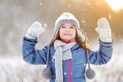 Funny little girl having fun in winter park stock images