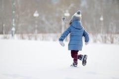 Funny little girl having fun in winter park Royalty Free Stock Photos
