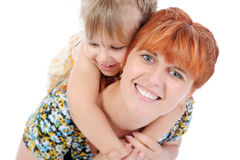 Funny little girl with her mother. Royalty Free Stock Photography