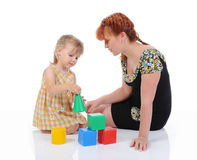 Funny little girl with her mother. Stock Photography
