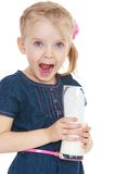 Funny little girl holding a glass of milk , close Royalty Free Stock Images