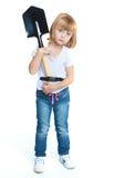 Funny little girl holding a Sapper shovel Stock Images