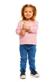 Funny little girl holding yellow toothbrush Stock Images