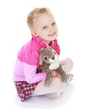 Funny little girl hugging a toy rabbit Royalty Free Stock Image