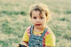 Funny little girl with ice cream. The girl was stained with a sweet dessert Stock Photography