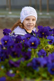 Funny little girl in jacket and hat Royalty Free Stock Images