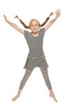 Funny little girl jumping Stock Images