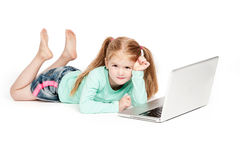 Funny Little Girl With Laptop Computer. Young girl with laptop. Isolated on white background Royalty Free Stock Photography