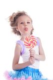 Funny little girl with lollipop Stock Photo