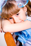 Funny little girl looking at camera Stock Photo