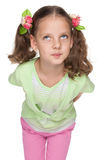Funny little girl looks up Royalty Free Stock Image