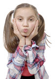 Funny little girl making faces Stock Images
