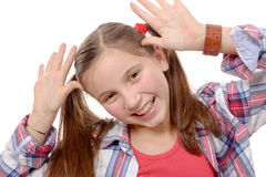 Funny little girl making faces Royalty Free Stock Images