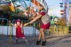 Funny little girl with mom having fun in amusement park Royalty Free Stock Photography