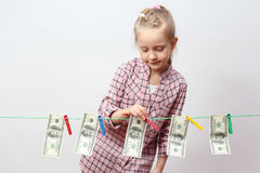 Little girl with money Royalty Free Stock Photography